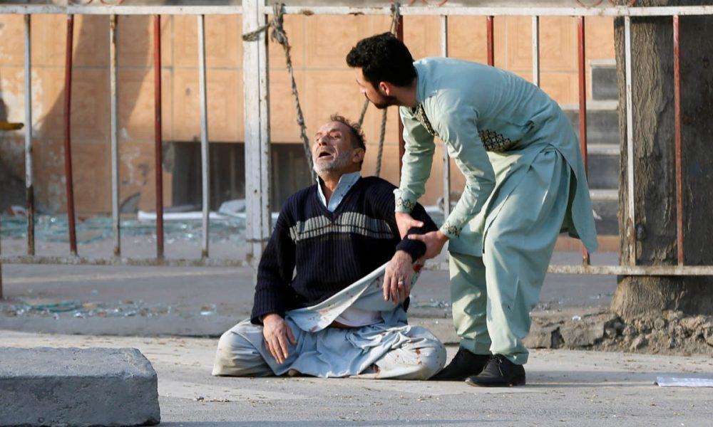 Man crying over the death of his son in Kabul. www.aljazeera.com