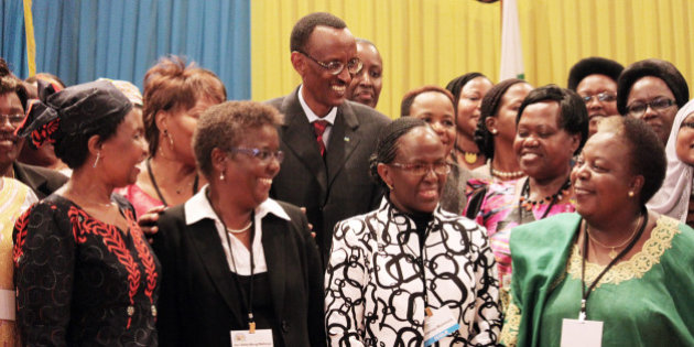 WITH STORY RWANDA GENOCIDE POLITICS - In this photo of Monday, May, 17 , 2010, Rwandan President Paul Kagame, centre, takes part in a group photo at a conference on the role of women at the nation's parliament, Rwandan officials say the country's parliament has a higher percentage of women than any other parliament in the world. More than 50 percent of the parliament's lower house are women. (AP Photo/ Jason Straziuso)